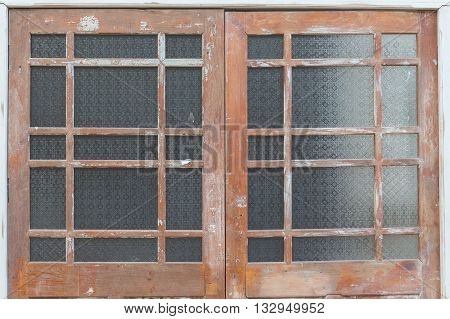 Wooden front door of a home. Old Wooden Door.