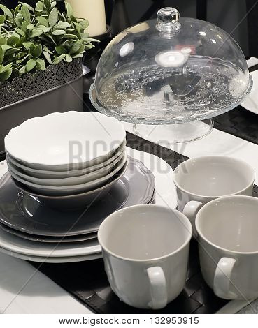 Kitchen Utensil Set of Ceramic Dishes Bowls Plates and and Coffee Cups Preparing for Serve Hot and Cold Food.