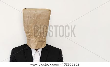 Businessman wearing brown paper bag, on white background