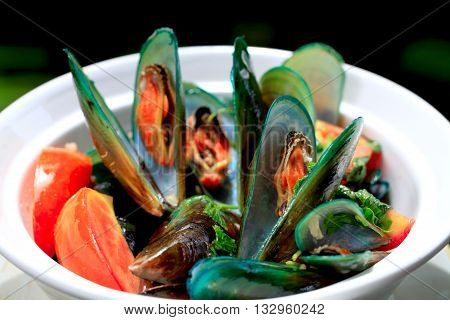 Mussels with red Tomato and parsley in a pan