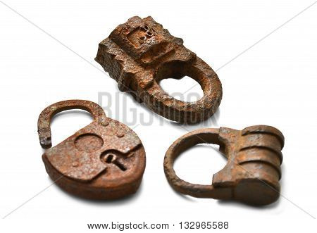 Three old rusty lock on a white background top close-up