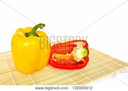 Yellow and Red sweet peppers isolated on a white background