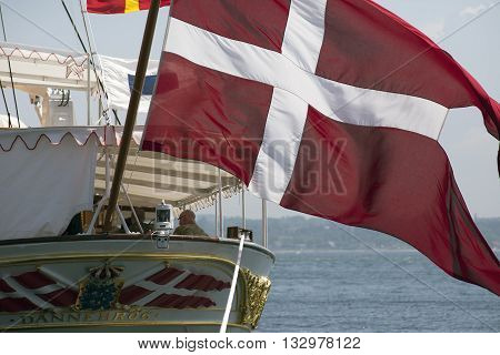 FREDERICIA DENMARK - 2016 Jun 5: The Danish royal yacht Dannebrog at berth in Fredericia harbor. Stern on the ship with windy flag.
