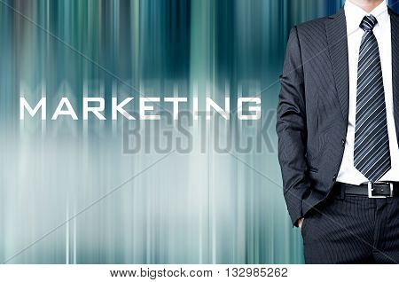 Marketing Sign On Motion Blur Abstract Background With Standing Businessman