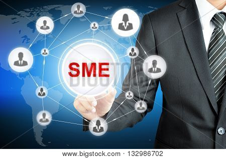 Businessman Pointing On Sme (small & Medium Enterprise) Sign On Virtual Screen With People Icons Lin