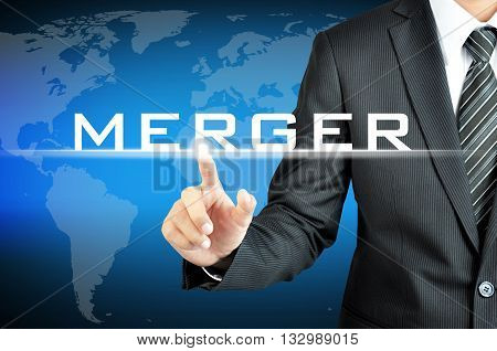 Businessman Hand Pointing To Merger Sign On Virtual Screen