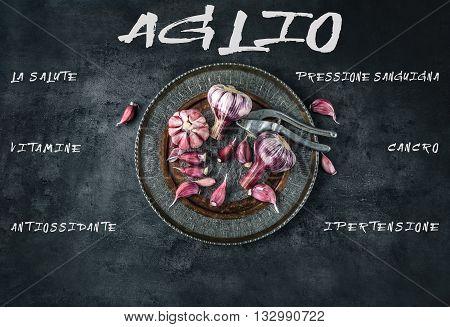 Garlic. Fresh garlic. Red garlic. Garlic press. Violet garlic.Garlic background. garlic bulbs. Medical healt concept. Italian text.
