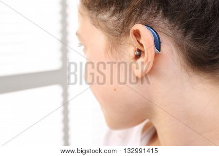 A child with a hearing aid .