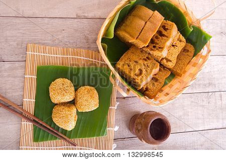 Malaysia desert Onde-Onde or known as Chinese Sesame Ball on banana leaf.Ma Lai Gou-Traditional malaysia steamed cake.
