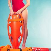 Lifeguard with rescue tube buoy. Woman supervising swimming pool water. Accident prevention and rescue. poster