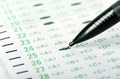 An answer sheet or optical mark recognition sheet with a mechanical pencil. poster