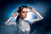 Woman in Silver Costume and Steampunk Glasses poster