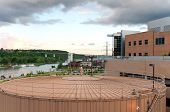 downtown saint paul overlooking mississippi river and city landmarks including storage tank for district energy system poster