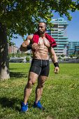 Handsome Muscular Shirtless Hunk Man Outdoor in City Setting. Showing Healthy Body While Looking away poster