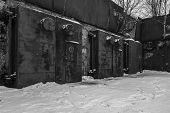Nuclear bunker. Nuclear bomb shelter. Old abandoned Soviet Cold War bunker in forest. Locked steel gate with ventilation vents. Black and white photo. poster