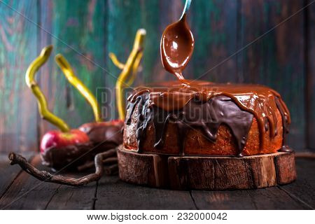 Cake With Chocolate And Caramel Icing In Rustic Style