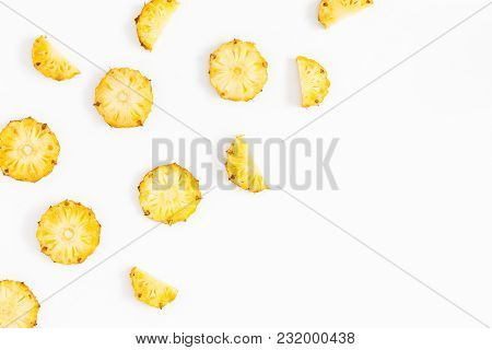 Pineapples On White Background. Pattern Made Of Sliced Pineapples. Flat Lay, Top View, Copy Space