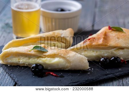 Camembert Cheese Pie With Olives And Basil
