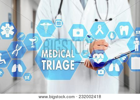 Medical Doctor With Stethoscope And Medical Triage Sign In Medical Network Connection On The Virtual