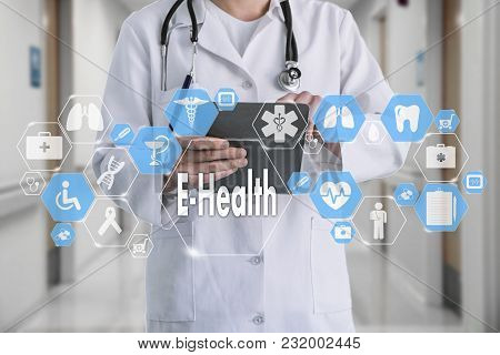 Medical Doctor With Stethoscope And E-health Word In Medical Network Connection On The Virtual Scree