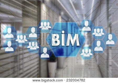 Building Information Modeling. Bim  On The Touch Screen With A Blur Background Of The Office.the Con