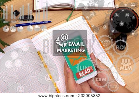 Email Marketing On The Touch Screen To The Network, On Office Blur Background.concept Of Email Marke