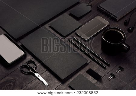 Blank Black Corporate Stationery With Phone On Dark Stylish Wood Background, Inclined, Closeup. Bran