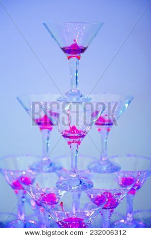 Wine Glasses In A Pyramid. Transparent Glasses Of Champagne At The Bar.