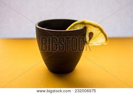 Alcoholic Drink With Lemon On White Background