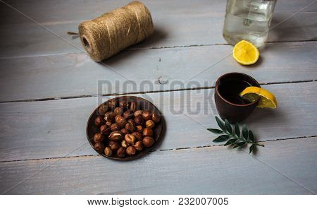 Alcoholic Drink With Lemon On Wooden Background