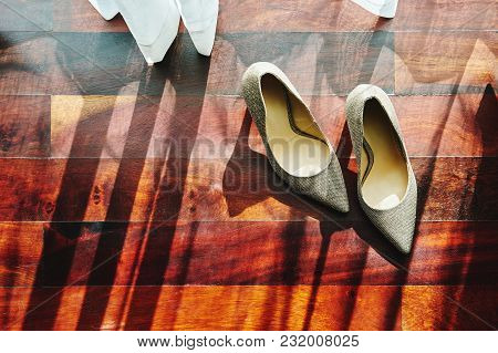 The Sun Light Through Curtain, The Glittering Shoes With Shadow On The Wooden Floor