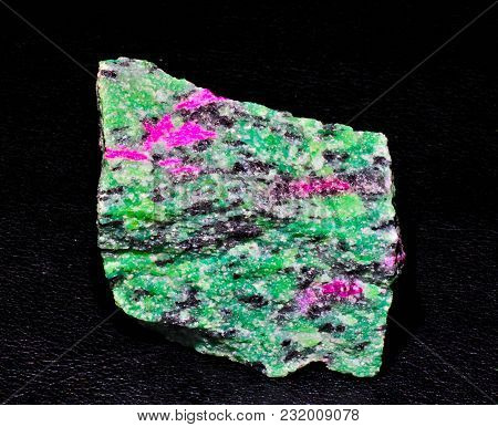 Ruby Corindone In Fuchsite Mineral Green Stone On Black Background