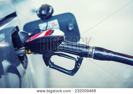 Gas Station. Pumping The Fuel Diesel Or Petrol On Gas Station.