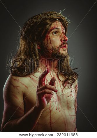 Passion, representation of the Calvary of Jesus Christ on the cross. Holy Week in Spain. man with crown of thorns