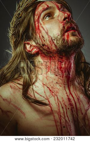 Religion, representation of the Calvary of Jesus Christ on the cross. Holy Week in Spain. man with crown of thorns