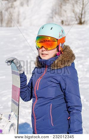 Photo Of Sporty Woman Wearing Helmet With Snowboard In Winter