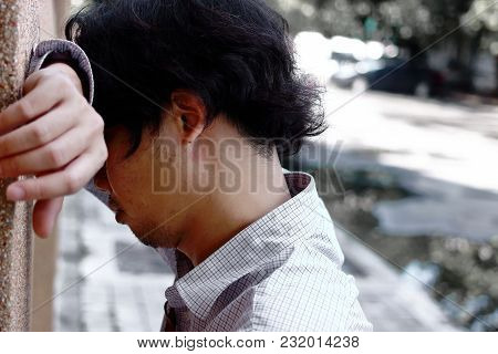 Sad Anxious Young Asian Business Man Suffering From Severe Depression.