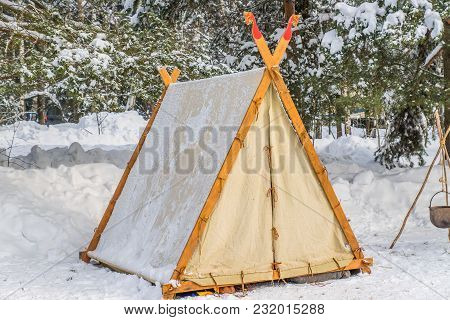 Tent Wigwam In Winter Forest Under The Trees