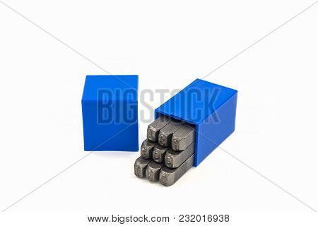 The Metal Lettering Stamps Punch Set In A Plastic Box On The White Background.