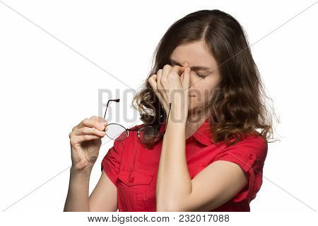 Beautiful Young Girl In A Red Shirt On A White Background Who Has Sore Eyes And A Head From Glasses
