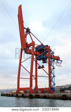Cargo Container Crane At The Edge Of The Water