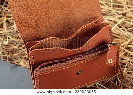Hand Made Brown Leather Man Wallet . Multi Colored. Leather Craft.on Dark Background.top View.closeu