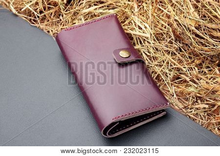 Hand Made Red Leather Man Wallet . Multi Colored. Leather Craft.on Dark Background.top View.