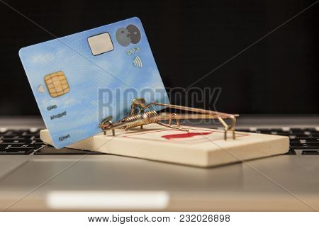 Concept Photo, Credit Card Placed In A Trap, The Risk Of Buying And Investing In The Network, Close