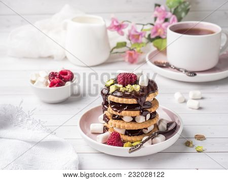 A Sweet Dessert Of A Chocolate Cookie Raspberry And Marshmallow Cup Of Coffee On A Light Table.