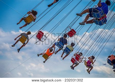 Chicago, Il, July 02, 2017: Children Ride The Wave Swinger, At Navy Pier, Which Attracts More Than N