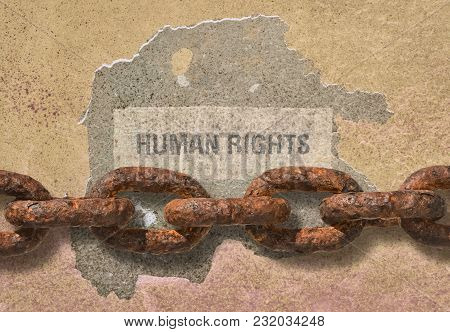 Text Human Rights Written On Rough Background And A Thick Rusty Chain