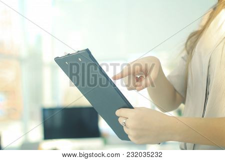 Closeup.business Woman Reviewing The Conditions Of The Contract.photo With Copy Space
