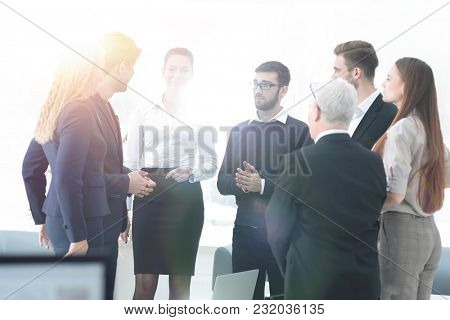 successful business team discussing documents and ideas standing near desktop