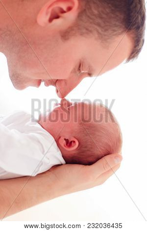 Portrait Of Young Father With Newborn Baby Daughter